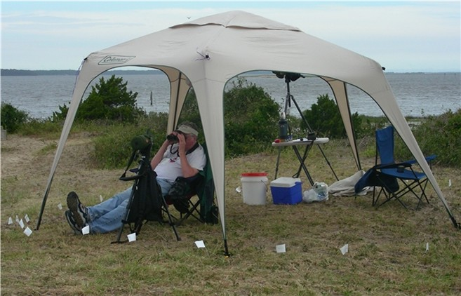 John Ennis siting in the count circle (circle marked by white flags). Photo by circle Fort Fisher, 2006.