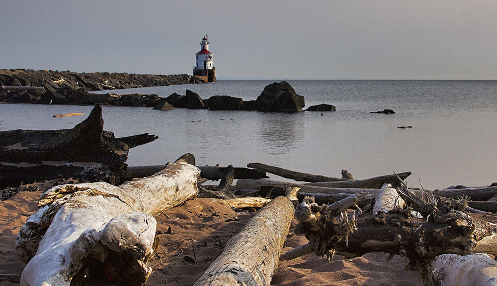Wisconsin Point, Driftwood and Lighthouse by Randen Peterson / Wikimedia