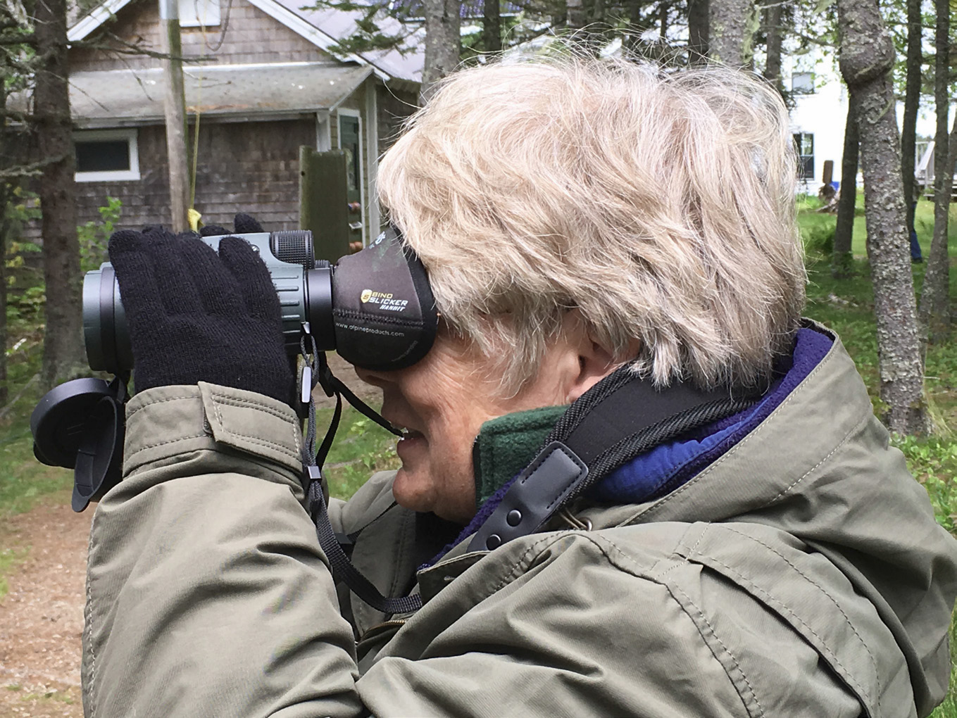 This lightweight mask slips over a binocular's eye-pieces and blocks out peripheral light. While birding in Portugal, the author used this novel device and found that it sharpened her focus.  Photo by Dawn Hewitt.
